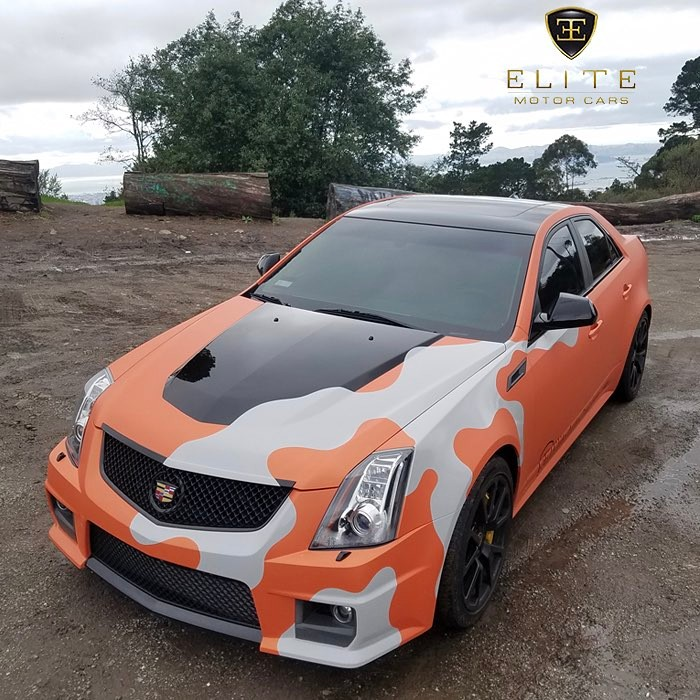 Cadillac wrapped in Arlon 2600 LX Sunkiss Aluminum Orange
