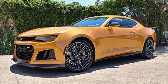 Chevrolet Camaro wrapped in Avery SW Gloss Gold Orange Pearlescent