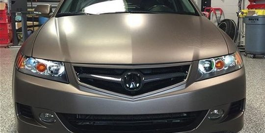 Acura wrapped in Matte Brown Metallic vinyl