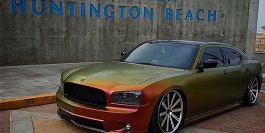 Dodge wrapped in Avery ColorFlow Satin Rising Sun Red/Gold shade shifting vinyl