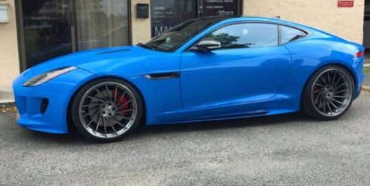 Jaguar wrapped in Avery SW Gloss Light Blue vinyl