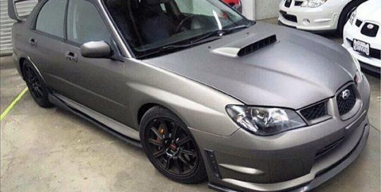 Subaru wrapped in Matte Charcoal Metallic vinyl