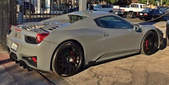 Ferrari wrapped in Avery SW Gloss Dark Grey vinyl