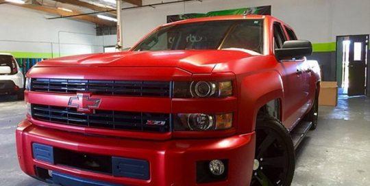Chevrolet wrapped in 3M 1080 Satin Smoldering Red vinyl