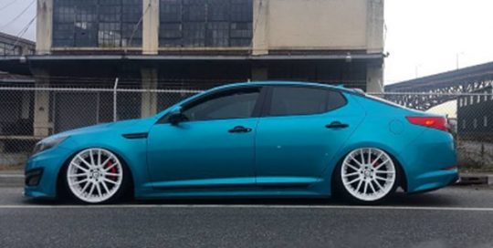 KIA wrapped in 3M 1080-G356 Gloss Atomic Teal