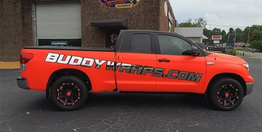 Ford wrapped in Neon Fluorescent Red vinyl with Avery SW Silver Chrome & Satin Black vinyl graphics