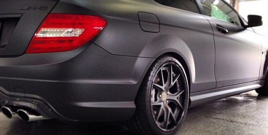 Mercedes Benz wrapped in matte black Avery over gloss black