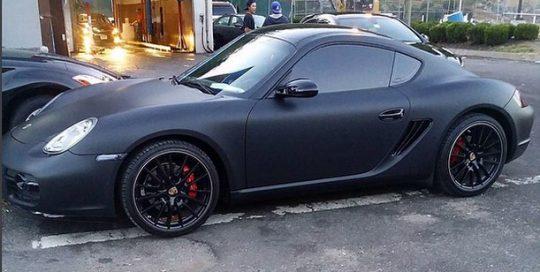 Porsche Cayman wrapped in 1080 Matte Deep Black vinyl