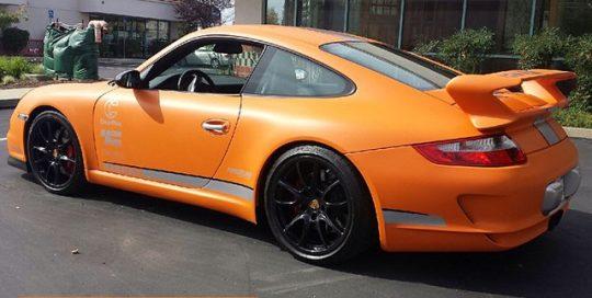 Porsche wrapped in Avery SW Matte Orange vinyl