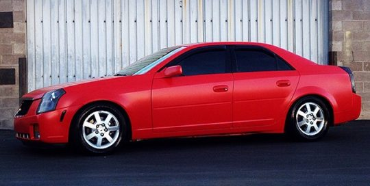 Cadillac wrapped in Avery SW900 Satin Carmine Red vinyl