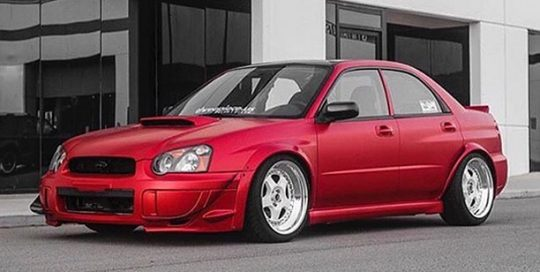 Subaru wrapped in 3M 1080-S363 Satin Smoldering Red