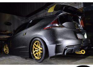 Honda wrapped in Orafol 975 Textured Black Honeycomb and Arlon Gold Chrome vinyls