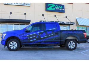 Ford wrapped in custom printed Avery 1105EZRS vinyl with 1380z Matte overlaminate