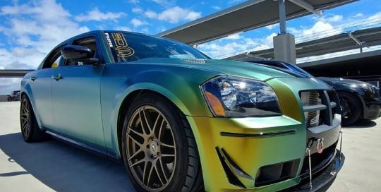 Chrysler 300 wrapped in Avery ColorFlow Fresh Spring Gold/Silver shade shifting vinyl