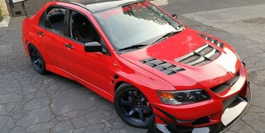 Mitsubishi Evolution wrapped in Avery SW Gloss Carmine Red vinyl