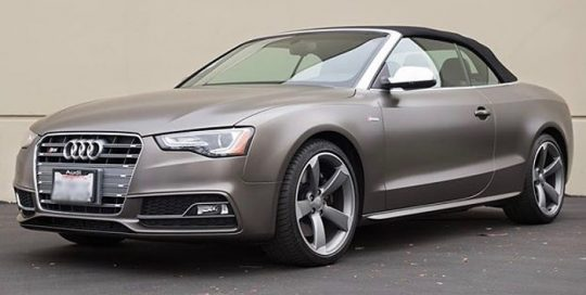 Audi S5 wrapped in Gloss Charcoal Metallic with 8519 Satin overlaminate