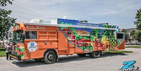 Bus wrapped in custom printed Arlon SLX Flight Technology vinyl and 3270 overlaminate