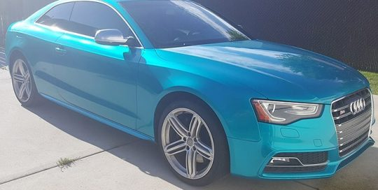 Audi S5 wrapped in Gloss Atomic Teal vinyl