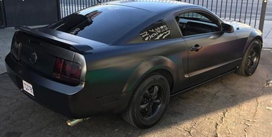 Ford Mustang wrapped in Satin Black vinyl