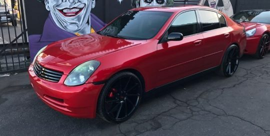 Infiniti G35 wrapped in Gloss Dragon Fire Red vinyl