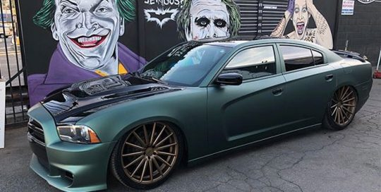 Dodge Charger wrapped in Matte Pine Green Metallic vinyl