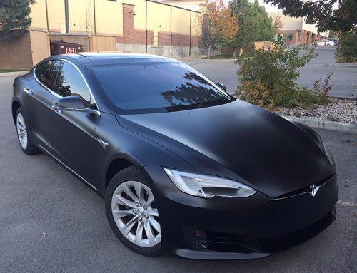 Tesla Car wrapped in Satin Black vinyl