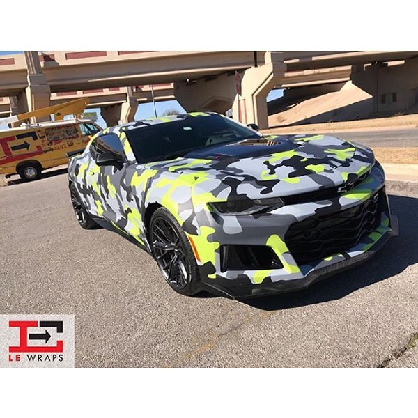 Chevrolet Camaro wrapped in custom printed camo on Avery 1105EZRS vinyl with 1380z Matte overlaminate