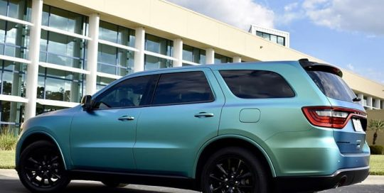 Dodge Durango wrapped in Orafol 970RA Shift Effect Matte Aquamarine shade shifting vinyl