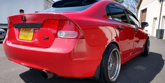 Honda Civic wrapped in Avery SW Diamond Red vinyl