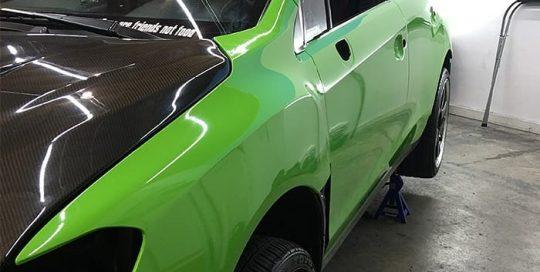 Subaru STI wrapped in Avery SW Gloss Grass Green vinyl