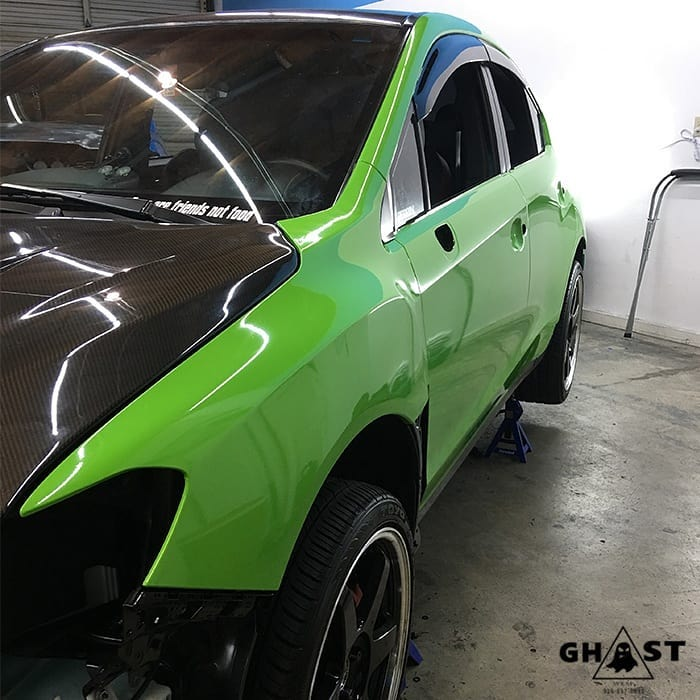 Subaru STI wrapped in Avery SW Gloss Grass Green vinyl