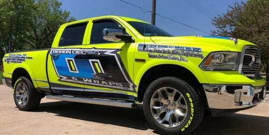 Dodge Ram wrapped in Satin Neon Fluorescent Yellow vinyl with custom printed Orafol 3751RA and 290 Matte Overlaminate