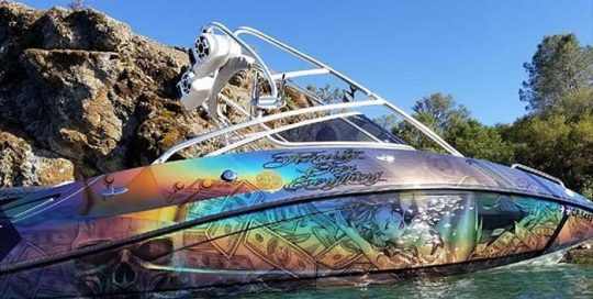 Boat Wrap wrapped in ColorFlip Gloss Psychedelic shade shifting vinyl and Avery DOL 6460 Gloss overlaminate
