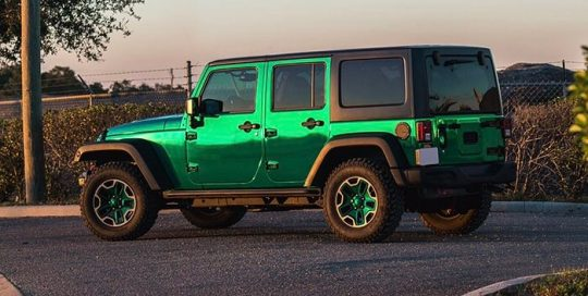 Jeep Wrangler wrapped in Avery SW Silver Chrome overlaminated with Avery SF100 Transparent Green vinyl