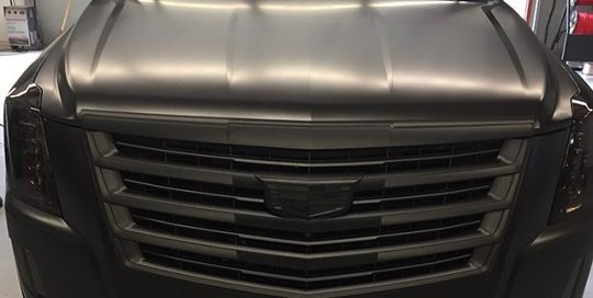 Cadillac Escalade wrapped in Avery SW Satin Black vinyl