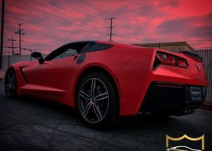 Chevrolet Corvette wrapped in Avery SW Satin Carmine Red vinyl