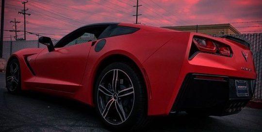 Chevrolet Corvette wrapped in Avery SW Satin Carmine Red vinyl