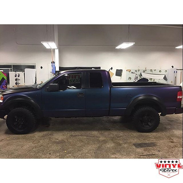 Ford F150 wrapped in Avery ColorFlow Satin Rushing Riptide Cyan/Purple shade shifting vinyl