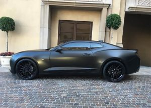 Chevrolet Camaro wrapped in Satin Black vinyl
