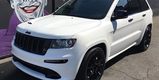 Jeep Cherokee wrapped in Satin Pearl White vinyl