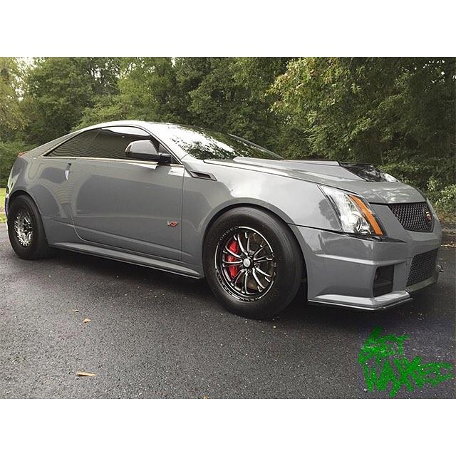 Cadillac CTSV wrapped in Avery SW Gloss Dark Grey vinyl