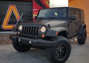 Jeep Wrangler wrapped in Matte Deep Black vinyl