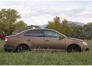Volkswagen GLI wrapped in Matte Brown Metallic vinyl