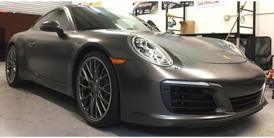 Porsche 911 wrapped in Avery SW Satin Pearl Nero vinyl