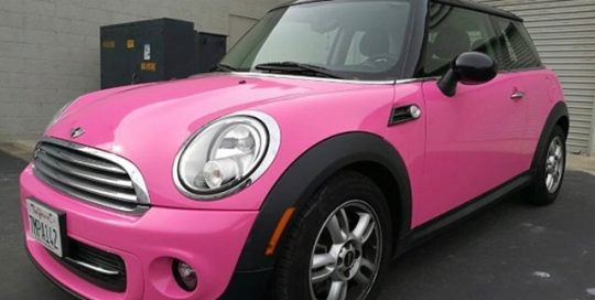 Mini Cooper wrapped in Gloss Hot Pink vinyl