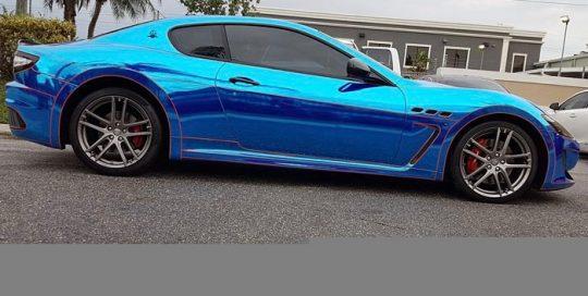 Maserati wrapped in Avery Blue Chrome and 1200 Orange Reflective vinyls