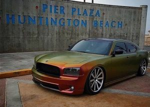 Dodge Charger wrapped in Avery ColorFlow Satin Rising Sun Red/Gold shade shifting vinyl