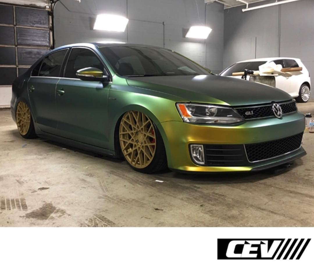 Volkswagen Jettagti wrapped in Avery SW ColorFlow Satin Fresh Spring Gold/Silver shade shifting vinyl