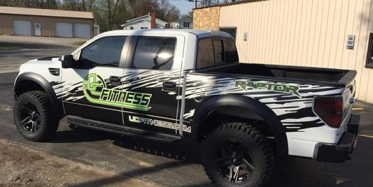 Ford Raptor Commercial Truck wrapped in Orafol 970RA Matte Black and custom printed 3951 vinyls