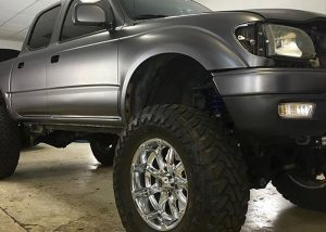 Toyota Tacoma wrapped in Satin Dark Gray vinyl